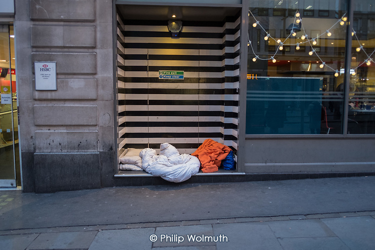Rough sleeper's bedding in a doorway in The Strand, central London.