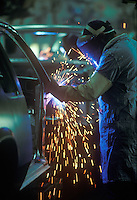 United Auto Worker spot welds American made car in Detroit.