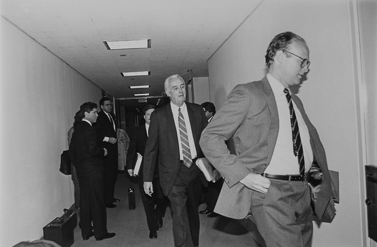 As Newsday executive looks on, Special Counsel Peter E. Fleming arrives with assistants at 640-B Hart Senate Office Building, for first testimony of the reporters subpoenaed regarding C. Thomas and A. Hile hearing leak. Tim Phelps at Newsday on Feb. 13, 1992. (Photo by Maureen Keating/CQ Roll Call via Getty Images)