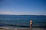 Kathleen tiptoes into the Puget Sound at Golden Gardens Park in Seattle, WA summer 2009.