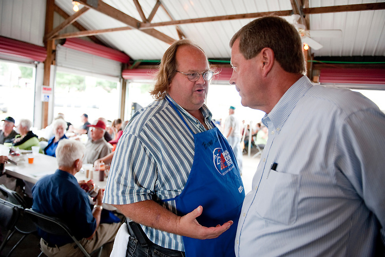 UNITED STATES - AUGUST 16:  Rep. Tom Latham, R-Iowa, right, talks with Roger Schonhorst of Slater, Iowa, at the Iowa Pork Producers Association pavilion at the Iowa State Fair in Des Moines, Iowa.  (Photo By Tom Williams/Roll Call)