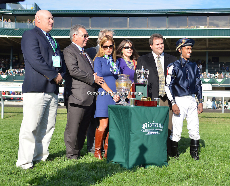 Trainer Mike Maker, jockey Rajiv Maragh and others accept the trophy for Joha's win the Dixiana Breeders' Futurity at Keeneland Racecourse.October 6, 2012.