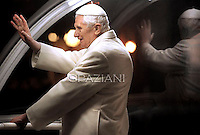 Pope Benedict XVI prays in front of the nativity crib in Saint Peter's Square after celebrating the Vespers and Te Deum prayers in Saint Peter's Basilica at the Vatican on December 31, 2011.