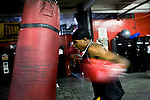 Delen Parsley, Blimps's son, hits the heavy bag on the week before the finals..Gleason's Gym has continued its long standing tradition in the boxing world as a training ground of competitors by putting 5 fighters into the finals of the 2006 Golden Gloves amateur boxing competition.. An inside look at the last 10 days of training for the 5 young fighters.
