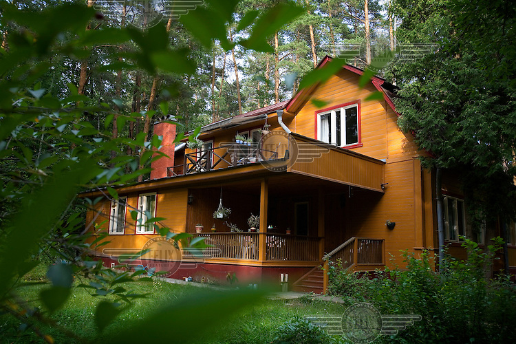 A dacha in woods outside the city.
