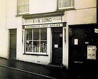 BNPS.co.uk (01202 558833)<br /> Pic: CharmouthHistorySociety/BNPS<br /> <br /> The Post Office has moved around the village during its 224 year old history.<br /> <br /> One of Britain's oldest post offices has permanently closed after 224 years due to the government's 'disgraceful and illogical' modernisation of the service.<br /> <br /> The popular branch, which was run by veteran postmasters Steve and Gill Pile, had served the seaside community of Charmouth in Dorset since 1795.<br /> <br /> But they have decided to retire after the Post Office Ltd insisted the post office was downsized and moved to another shop in the village under their 'Network Transformation Scheme'.<br /> <br /> Since Post Office Ltd have so far not been able to find an alternative venue, the village of 1,300 people is currently without a post office which also provided its only free cash point service - leaving some villagers 'in tears' and wondering how they will cope.