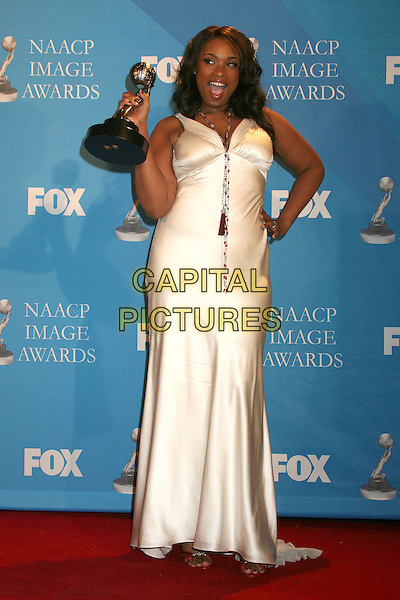 JENNIFER HUDSON.38th Annual NAACP Image Awards at the Shrine Auditorium - Press Room, Los Angeles, California, USA, .2 March 2007..full length winner trophy cream white dress hand on hip.CAP/ADM/BP.©Byron Purvis/AdMedia/Capital Pictures.