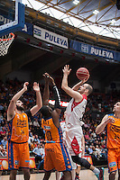 VALENCIA, SPAIN - APRIL 25: Romain Sato, Bojan Dubljevic and Pablo Aguilar during ENDESA LEAGUE match between Valencia Basket Club and Bruixa D'Or Basket at Fonteta Stadium on April 25, 2015 in Valencia, Spain