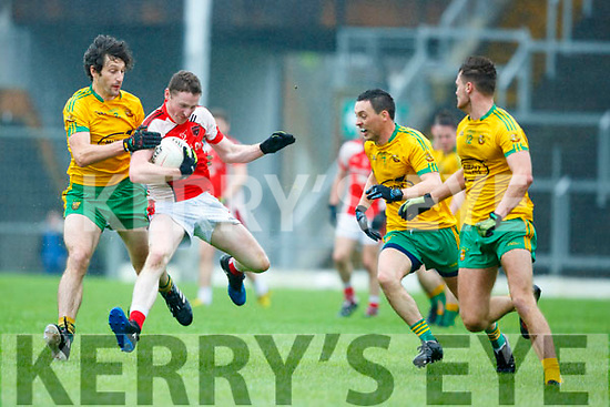 Daniel O'Sullivan Rathmore is tackled by Don Murphy Gneeveguilla