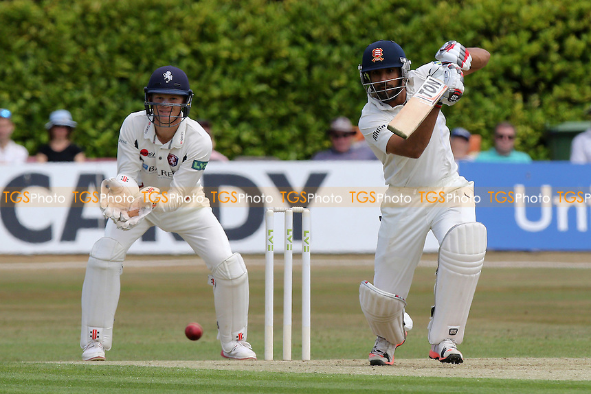 Ravi Bopara drives four runs for Essex as Sam Billings looks on from behind the stumps