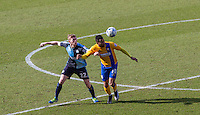 Jason McCarthy of Wycombe Wanderers & Matt Green of Mansfield Town in action during the Sky Bet League 2 match between Wycombe Wanderers and Mansfield Town at Adams Park, High Wycombe, England on 25 March 2016. Photo by Andy Rowland.