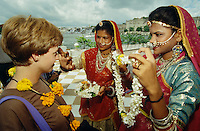 Traditional welcome with flowers for Royal Orient passengers at Lake Palace Hotel.