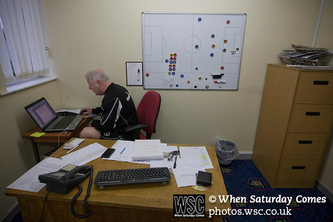 Rochdale v Tranmere Rovers preparations, 31/12/2010. Prenton Park, League One. Tranmere Rovers manager Les Parry in his office preparing a powerpoint presentation for a player briefing at the club's Prenton Park ground, the day before his team's Npower League 1 fixture away to Rochdale. It was the first league fixture between the teams since March 1989. Rochdale won this latest encounter by three goals to two watched by a crowd of 5,500. Photo by Colin McPherson.
