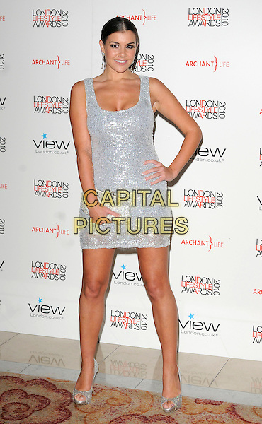 IMOGEN THOMAS.The London Lifestyle Awards, Park Plaza Riverbank Hotel, London, England..October 7th, 2010.full length silver dress sleeveless mini sequins sequined clutch bag peep toe shoes hand on hip.CAP/CAN.©Can Nguyen/Capital Pictures.