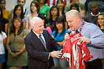 25 AUGUST 2008 -- PHOENIX, AZ:  US Sen John McCain (R-AZ), the presumptive Republican nominee for President, visits Central High School in downtown Phoenix, AZ, Monday, Aug 25. The Principal of the school, Christopher Jones (RIGHT) gave McCain a jersey with the number 1 on it to signify McCain's presidency. McCain  campaigned with Puerto Rican hip hop, reggaeton star Daddy Yankee (Ramon Ayala). Central High School is one of the most diverse high schools in Phoenix. More than 50 languages are spoken by students at the school.    PHOTO BY JACK KURTZ