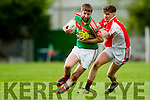 Eanna O Conchuir West Kerry in action against Kevin Gorman Kilcummin in the  Kerry County Football Championship on Saturday.