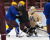 Connor Reilly (MN - 21), Travis Boyd (MN - 22), Michael Shibrowski (MN - 1) - The University of Minnesota Golden Gophers practiced on Wednesday, April 9, 2014, at the Wells Fargo Center during the 2014 Frozen Four in Philadelphia, Pennsylvania.