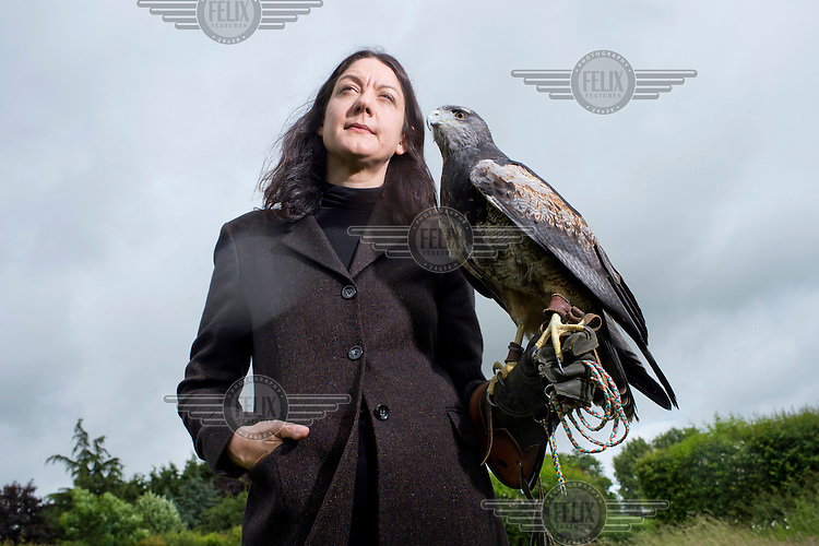 Helen McDonald author and the writer of 'H is for Hawk' at the Bird of Prey Sanctuary near Ipswich holding 'Murray' a Harrier Hawk.