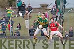 Kerry's Kieran Donaghy and Mayo's Liam O'Malley.