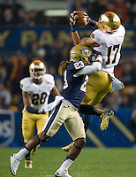 Irish wide receiver James Onwualu (17) catches a pass over Pittsburgh Panthers defensive back Lafayette Pitts (23) in the first quarter.