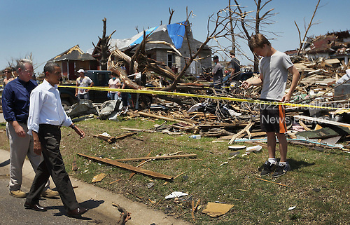 United States President Barack Obama and Missouri Governor Jay Nixon (L) walk together during a visit to the community that was devastated a week ago by a tornado on May 29, 2011 in Joplin, Missouri. The tornado, which was packing winds of more than 200 mph, is now considered to hold the record for the highest death toll in U.S. history.  .Credit: Joe Raedle / Pool via CNP