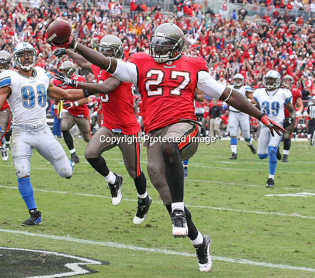 Tampa Bay Buccaneers running back LeGarrette Blount (27) scores the second touchdown for the Buccaneers against the Detroit Lions during an NFL football game between the Buccaneers and the Lions Sunday in Tampa, Fla, December 19, 2010. The Lions defeated the Buccaneers 23-20 in overtime. (AP/Margaret Bowles)