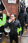 © Joel Goodman - 07973 332324 - all rights reserved . 11/11/2010 . London , UK . Afsor Ali , also known as Abu Assadullah . Muslims Against Crusades hold a demonstration and burn a poppy on the anniversary of Armistice Day , at Kensington Gore , opposed by a demonstration of nationalist groups including the English Defence League ( EDL ) . Photo credit : Joel Goodman