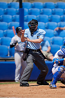 Home plate umpire Matt Carlyon calls a strike during a game between the Daytona Tortugas and the Dunedin Blue Jays on April 22, 2018 at Dunedin Stadium in Dunedin, Florida.  Daytona defeated Dunedin 5-1.  (Mike Janes/Four Seam Images)