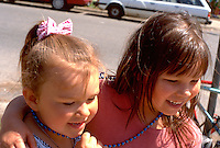 Sisters age 2 and 5. In the Heart of the Beast May Day Festival and Parade Minneapolis  Minnesota USA