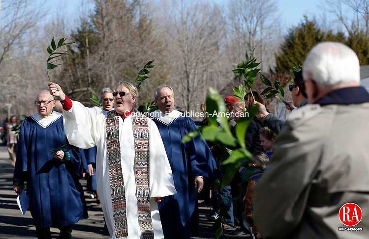 Woodbury, CT- 29 March 2015-032915CM01-  The Reverend Richard Koenig leads a Palm Sunday procession before 10 a.m. service at North Congregational Church in Woodbury on Sunday.  Palm Sunday commemorates Jesus' Christ entry into Jerusalem, and is the start of the Christian Holy Week.  Christopher Massa Republican-American