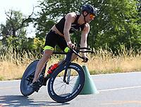 Philip Raschke (3. Platz am Ende) auf dem Fahrrad - Mörfelden-Walldorf 15.07.2018: 10. MöWathlon
