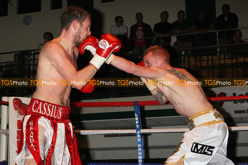 Cassius Connor (red/white shorts) defeats Sean Gorman in a Welterweight boxing contest at York Hall, Bethnal Green, promoted by Miranda Carter/Left Jab Promotions - 18/09/11 - MANDATORY CREDIT: Gavin Ellis/TGSPHOTO - Self billing applies where appropriate - 0845 094 6026 - contact@tgsphoto.co.uk - NO UNPAID USE.