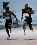 SHANGHAI, CHINA - MAY 19:  Asafa Powell (R) of Jamaica and Nesta Carter of Jamaica compete in the Men 100m during the Samsung Diamond League on May 19, 2012 at the Shanghai Stadium in Shanghai, China.  Photo by Victor Fraile / The Power of Sport Images