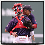 Pitcher Denyi Reyes (41) of the Greenville Drive embraces catcher Charlie Madden (3) after the last out in a complete-game win against the Hickory Crawdads 4-1 on Wednesday, July 25, 2018, at Fluor Field at the West End in Greenville, South Carolina. (Tom Priddy/Four Seam Images)