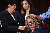 Christine Blasey Ford, the woman accusing Supreme Court nominee Brett Kavanaugh of sexually assaulting her at a party 36 years ago, is comforted by her attorney Debra S Katz at the end of her testimony before the US Senate Judiciary Committee on Capitol Hill in Washington, DC, September 27, 2018.  / POOL / SAUL LOEB
