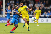 Anthony Grant of Peterborough United tackles Curtis Nelson of Oxford United during the Sky Bet League 1 match between Peterborough and Oxford United at the ABAX Stadium, London Road, Peterborough, England on 30 September 2017. Photo by David Horn.