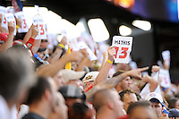 Fans hold signs honoring former MLS player Clint Mathis (not pictured) who recently retired. The Los Angeles Galaxy defeated the New York Red Bulls 1-0 during a Major League Soccer (MLS) match at Red Bull Arena in Harrison, NJ, on August 14, 2010.