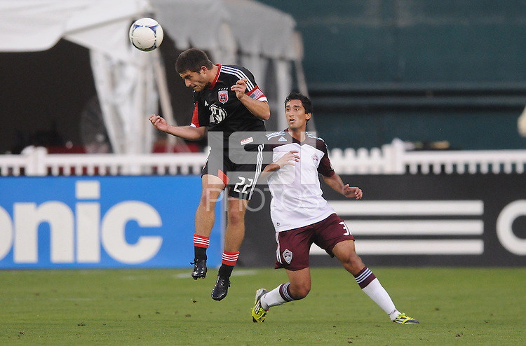 D.C. United defender Chris Korb (22) heads the ball while cover behind by Colorado Rapids midfielder Tony Cascio (32) D.C. United defeated the Colorado Rapids 2-0 at RFK Stadium, Wednesday May 16, 2012.