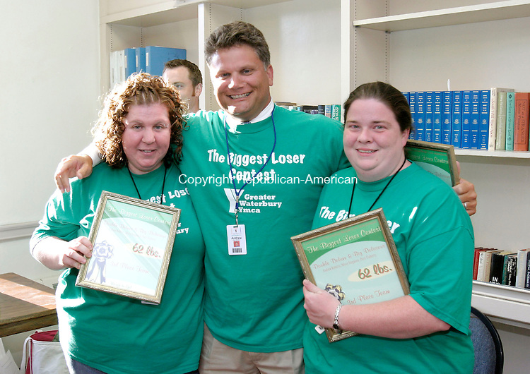 WATERBURY, CT, 17 July 2006- 071706BZ05- From left- Missy Ferguson, Andrew Roberts, and Patti Flaherty of Team Double Deluxe and Big Delicious took third place in the team weight-loss competition at the Waterbury YMCA.<br /> Jamison C. Bazinet Republican-American
