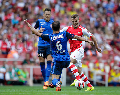 03.08.2014. London, England. Emirates Cup.  Arsenal versus AS Monaco.   Arsenal midfielder Jack WILSHERE takes on AS Monaco's Ricardo CARVALHO  With Monaco winning 0-1 and Valencia winning earlier in the day, Valencia won the tournament trophy.