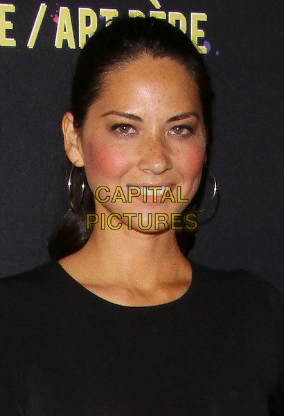 "OLIVIA MUNN.Art Mére Art Pére for Livestrong Event ""held at The Smashbox Studios, Hollywood, California, USA,.23rd September 2010..portrait headshot black smiling hair up hoop earrings .CAP/ADM/TC.©T. Conrad/AdMedia/Capital Pictures."
