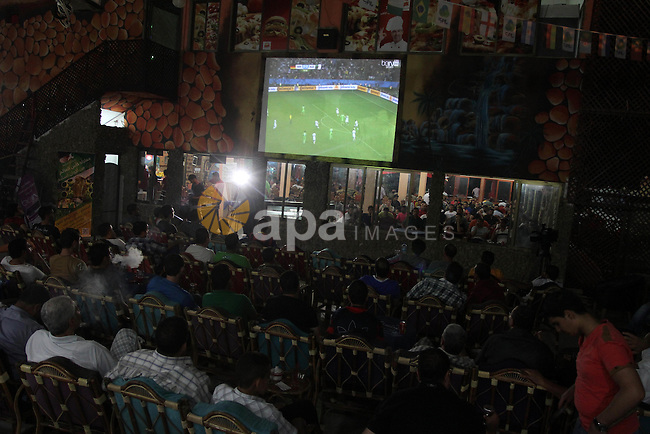 Palestinian supporters of the Algerian World Cup team watch the Brazil FIFA World Cup 2014 round of 16 match between Algeria and Germany in Gaza City on June 30, 2014. Photo by Mohammed Asad