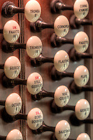Stop knobs on the console of a restored E. M. Skinner pipe organ in St. Michael's church in Jersey City, New Jersey