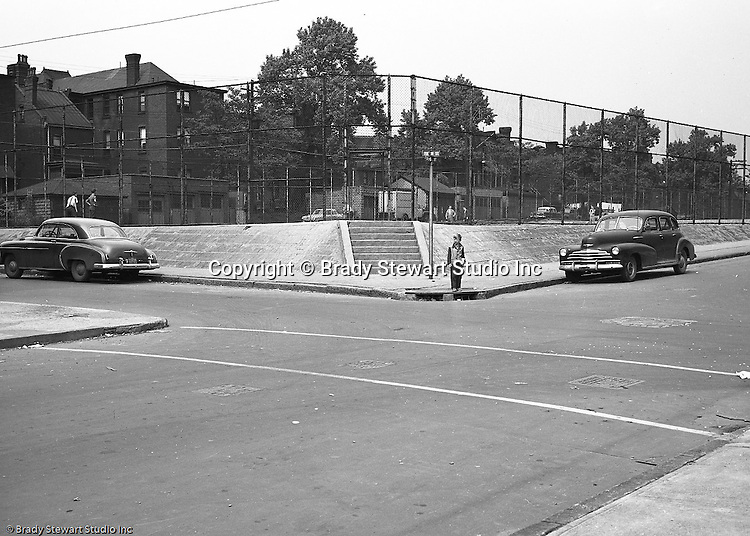 Pittsburgh PA:  Location photography of another Railway Express accident scene for attorney's Reed Smith, Shaw and McClay - 1953.  View of the Conroy Junior High playground at the corner of  Page and Fulton streets on the North Side of Pittsburgh.