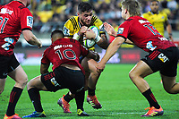 Richie Mo'unga tackles TJ Perenara during the Super Rugby match between the Hurricanes and Crusaders at Westpac Stadium in Wellington, New Zealand on Friday, 29 March 2019. Photo: Dave Lintott / lintottphoto.co.nz