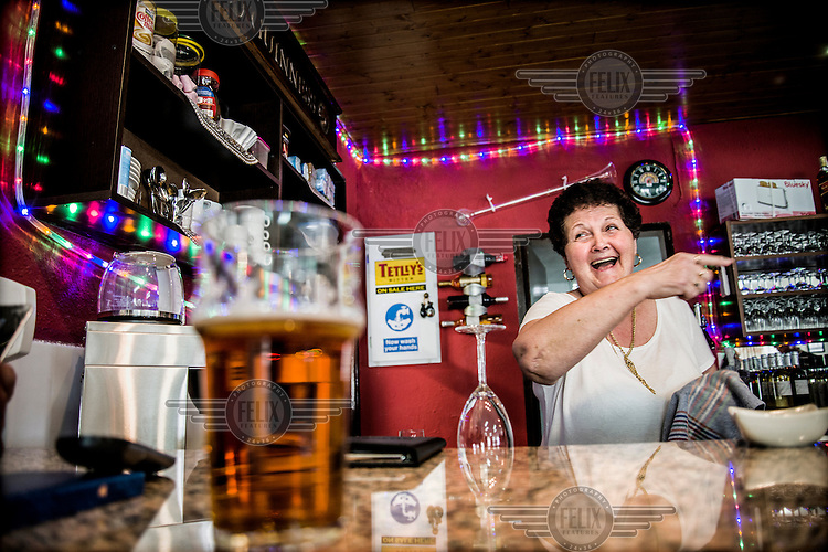 A woman who helps run the bar at the The English Speaking Club El Campello. Spain is home to more British ex-pats than anywhere else in the world, mostly concentrated in its Mediterranean regions and there are numerous clubs and organisations catering to this population. The English Speaking Club El Campello, whose president is former RAF and the vice-president a former policeman, organises raffles, dances, trips and games etc and has over 400 members.