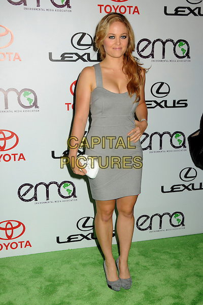 ERIKA CHRISTENSEN .at The 2010 Environmental Media Association Awards held at Sky Bar, Warner Bros Studios, Burbank, California, USA, October 16th 2010. .emas ema full length dress hand on hip shoes clutch bag white suede black heels grey gray .CAP/ADM/BP.©Byron Purvis/AdMedia/Capital Pictures.