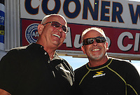 Nov 14, 2010; Pomona, CA, USA; NHRA funny car driver Gary Densham (left) talks with dragster driver Cory McClenathan during the Auto Club Finals at Auto Club Raceway at Pomona. Mandatory Credit: Mark J. Rebilas-