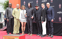 14 May 2019 - Hollywood, California - Lance Reddick, Laurence Fishburne, Halle Berry, Keanu Reeves, Ian McShane, Asia Kate Dillon, Mark Dacascos. Keanu Reeves Places His Hand Prints In Cement At TCL Chinese Theatre IMAX Forecourt.   <br /> CAP/ADM/PMA<br /> ©PMA/ADM/Capital Pictures