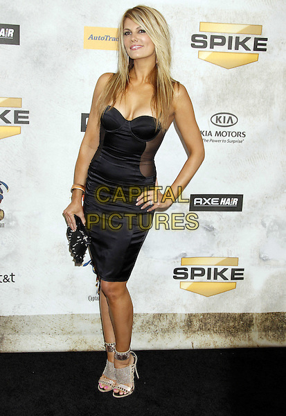 "COURTNEY HANSEN.Spike TV's ""Guys Choice"" Awards 2010 held at Sony Pictures Studios, Culver City, California, USA..June 5th, 2010.full length black dress hand on hip corset bustier clutch bag.CAP/ADM/MJ.©Michael Jade/AdMedia/Capital Pictures."